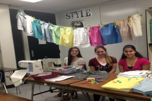 Members of Fashion Club showing off the dresses they made for the charity Little Dresses 4 Africa. Photo Credit: CHEYENNE PINO
