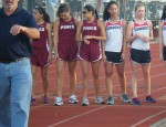 Coach Snipes directing the track team during a meet. Photo Credit: JP PORTRAITS