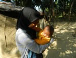 CCHS Senior Salma Khan with a child she met in Bangladesh. Photo Courtesy Of SALMA KHAN
